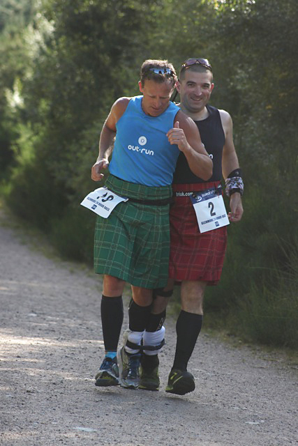 world record holders for 24 hr                 three-legged running: Mark Howlett (left) and Rab Lee                 (right)