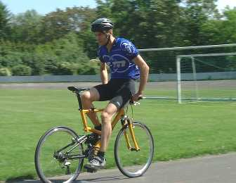 A guy bicycling backwards.